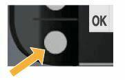 pulse el boton jusnto a OK en el panel de control de la impresora
